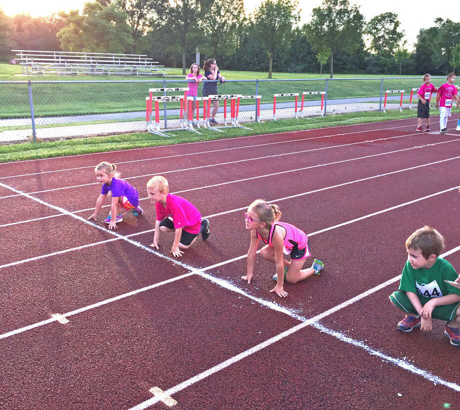 Young athletes line up to start a race during an Edwardsville summer track meet on June 12. The second and final session for this year is on Friday at the EHS track Photo: For The Intelligencer