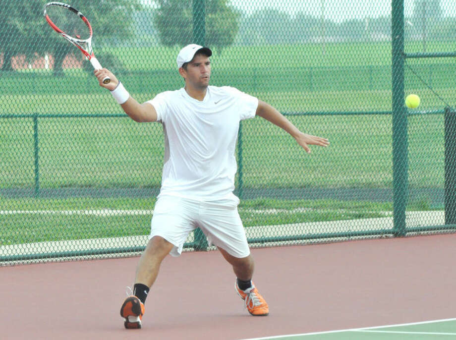 Blake Bazarnik prepares to hit a return shot on Saturday at Liberty Middle School during the qualifying tournament for the Edwardsville Futures Tournament. Bazarnik was eliminated with a 7-6, 3-6, 6-1 loss.