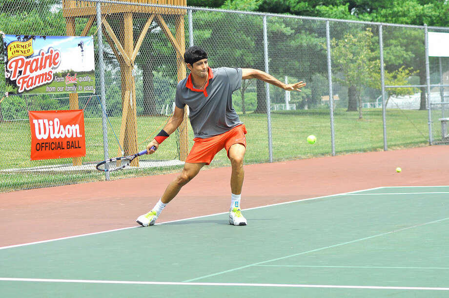 Marcelo Arevalo of El Salvador returns a shot Tuesday during a first-round singles match in the USTA Edwardsville Futures Pro Circuit Tennis Tournament.