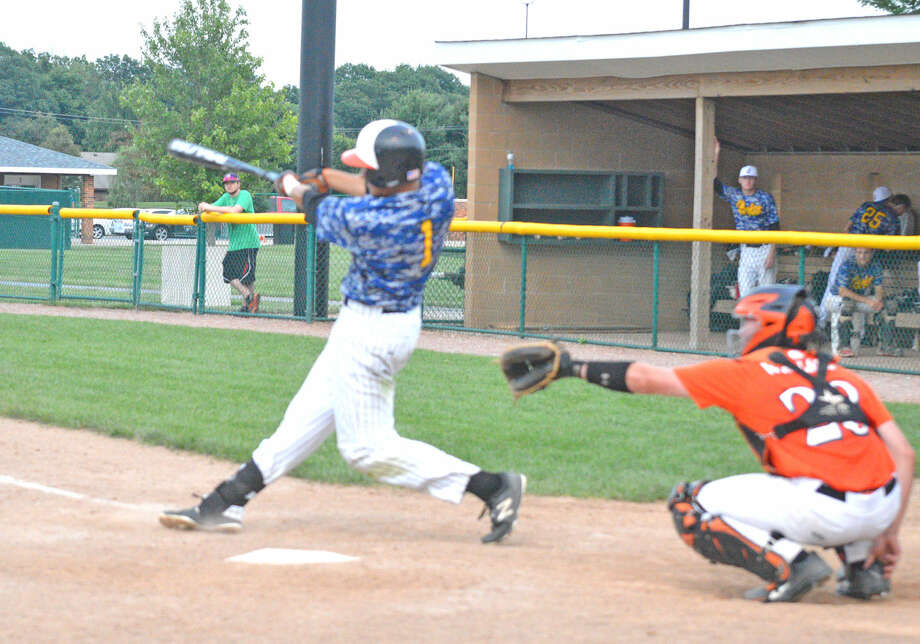 Jordan Hovey, a recent Edwardsville graduate, hits a solo home run for the Quakes in the eighth inning of their game Tuesday at Tom Pile Field against the EHS summer team.