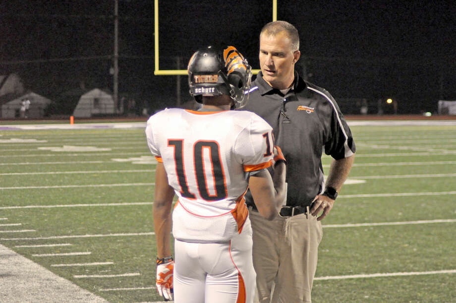 Edwardsville coach Matt Martin talks to sophomore Travis Anderson during a recent game. EHS (9-1) hosts Homewood-Flossmoor (8-2) at 6 p.m. tonight in a second-round Class 8A playoff game.
