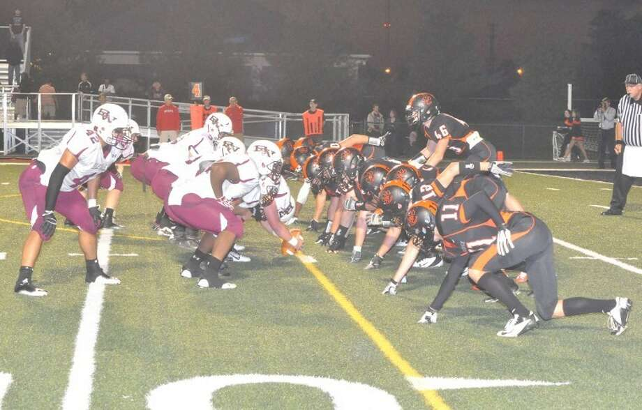 The Edwardsville defense lines up in the trenches across from the Belleville West offense on Friday at the District 7 Sports Complex. EHS shutout the Maroons 13-0 in a dominating defensive performance.