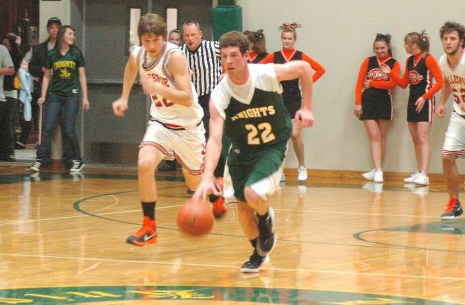 Metro-East Lutheran's Jacob Fanshier dribbles down court Wednesday against Gillespie at Thomas Hooks Gym. The Knights defeated the Miners 67-46.