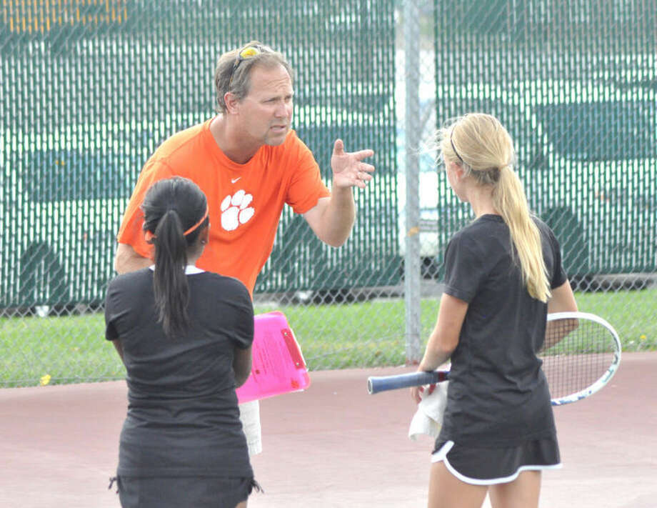 Edwardsville head coach Dave Lipe talks with EHS players Grace Trimpe and Noni Updyke during the Southern Illinois Duals at the EHS Tennis Center during the season. The Tigers compiled another spectacular season, including a Southwestern Conference title and a program record in dual wins.