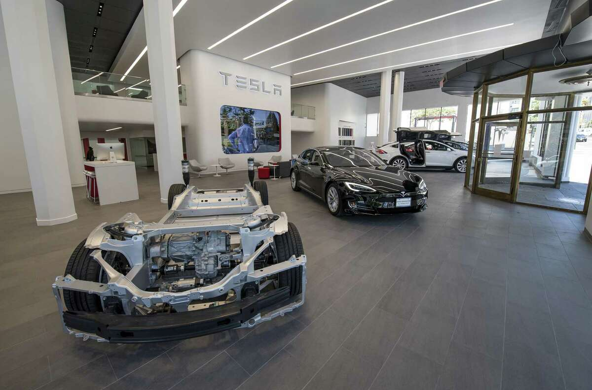 Tesla's Model X vehicles are displayed at the company's San Francisco showroom. Tesla briefly opened a pop-up shop at The Shops at La Cantera last year and has tried twice before to open a showroom in San Antonio.