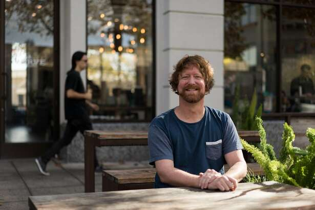 Stuart Thornton poses for a photograph at Verve Coffee in Santa Cruz, Calif. on Monday, Oct. 31, 2016. Thornton writes about travel and has published guidebooks.