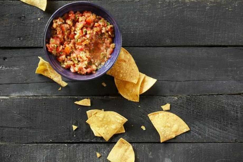 Refreshing salsa is a quick and easy treat to make for your next outdoor gathering.