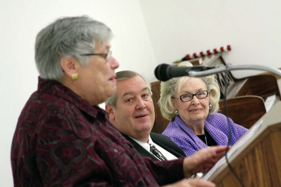 Carol Keene reads a tribute to Dolores Rohrkaste as Edwardsville Mayor Gary Niebur, and Rohrkaste listen. Photo: Marci Winters-McLaughlin/Intelligencer