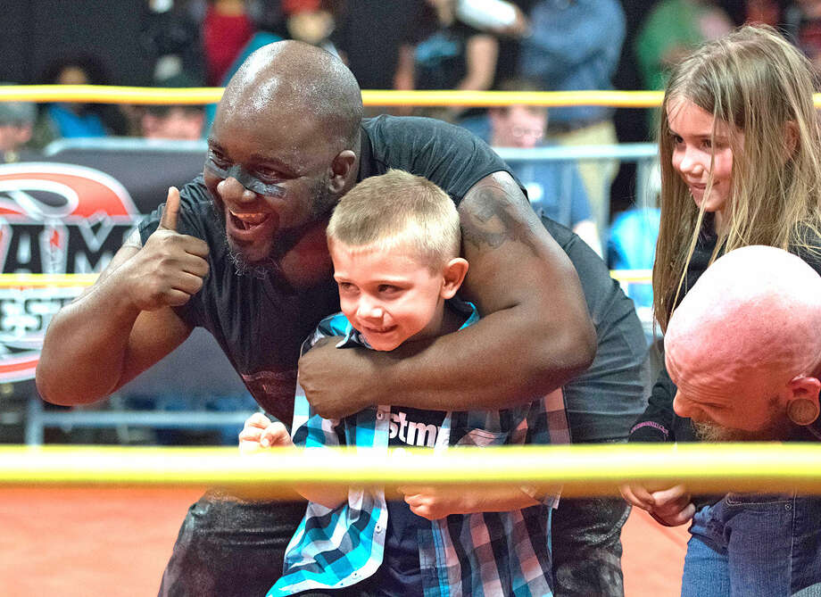 "The Don Mega"" Shorty Biggs poses with a young fan during a recent Dynamo Pro Wrestling event.  Photo: For The Intelligencer"