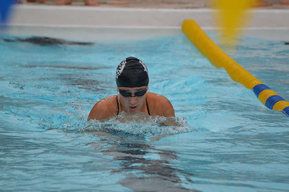 Sahar Rabiei swims in the girls' 13-14 150-yard breaststroke relay. The team finished the race in first place.