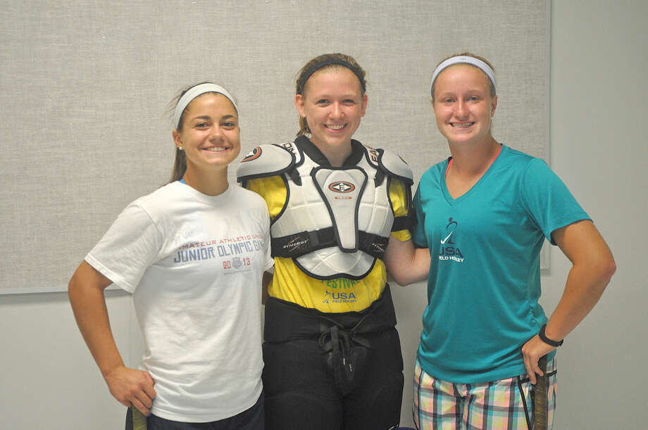 Edwardsville field hockey players Annie Mulford, left, Eliza Pauk, center, and Ryley Miller stayed busy during the summer by participating in summer camps and different programs.