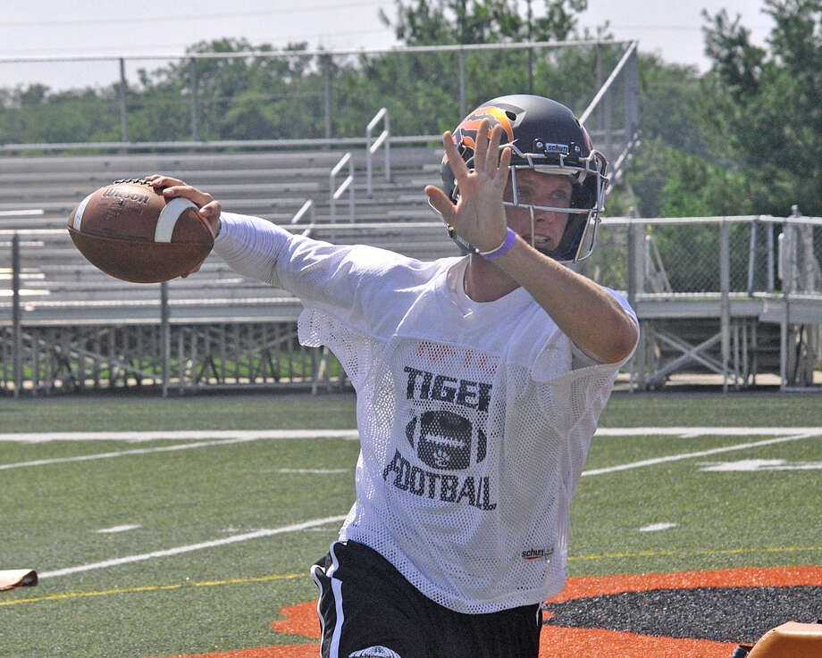 Edwardsville senior quarterback Dan Marinko throws a pass during a drill on Monday at the sports complex.