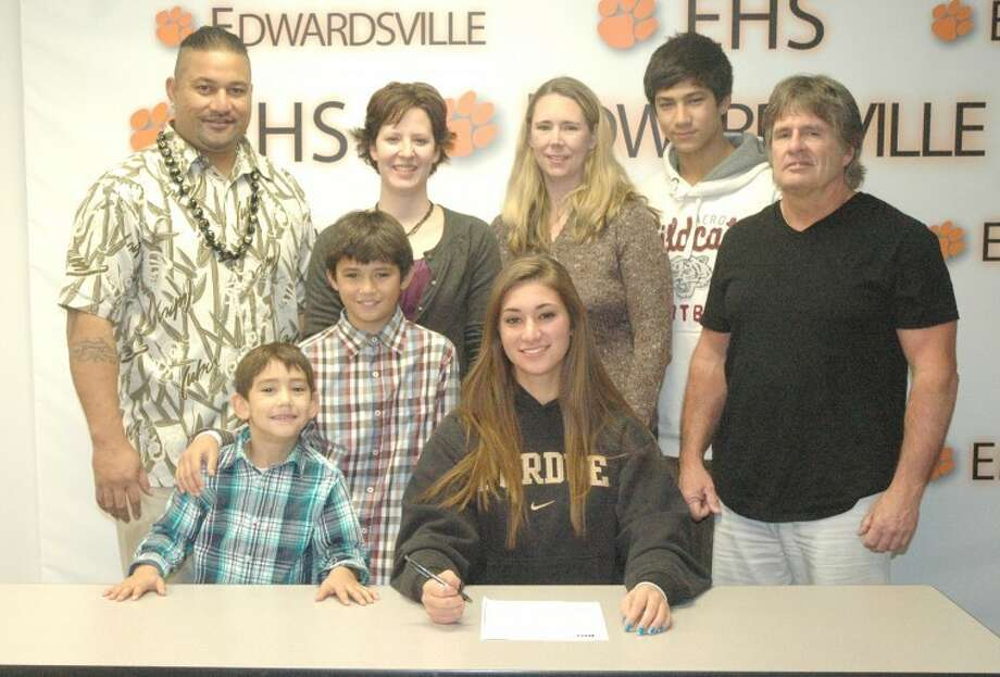 Edwardsville senior Sam Epenesa recently signed with Purdue University to continue her volleyball career. Pictured seated is Sam Epenesa. Standing from left to right are: Epenesa (Eppy) Epenesa, father; Iosefatu, brother; Eric, brother; EHS head coach Jami Parker; Stephanie Epenesa, mother; A.J. Epenesa, brother and physical therapist Mark Slaughter.