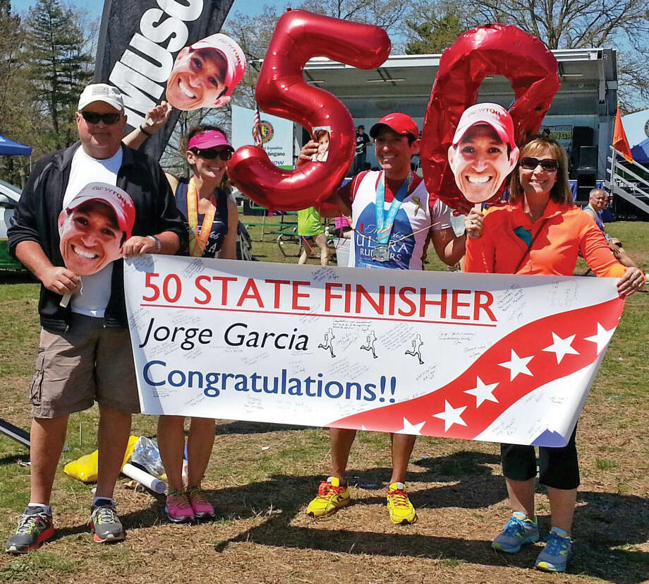 Jorge Garcia celebrates with friends after finishing a marathon in New York, and in doing so, finishing a marathon in all 50 states. Photo: For The Intelligencer