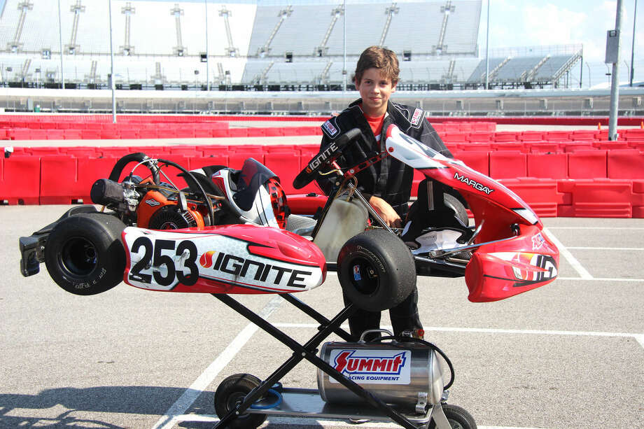 Evan Stamer, 13, of Edwardsville, poses with his kart at Gateway Kartplex, located inside Gateway Motorsports Park in Madison.
