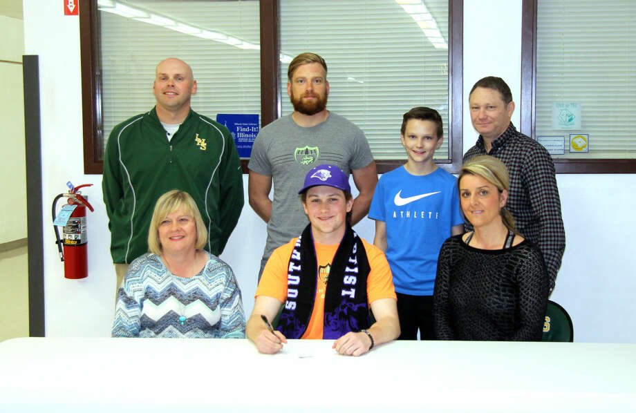 Metro-East Lutheran senior Reed Harmon recently signed to play soccer at Southwest Baptist University. Front row, left to right, mother Kren Harmon, Reed Harmon and stepmother Indira Harmon. In the back row are MELHS athletic director Rob Stock, MELHS coach Noah Enke, brother Jase Harmon and father Michael Harmon.
