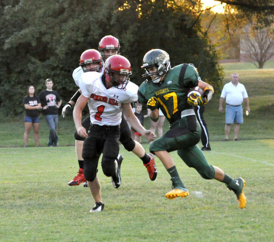 Metro-East Lutheran's Drew Kohler heads into the end zone to give his team a lead early in the first quarter.
