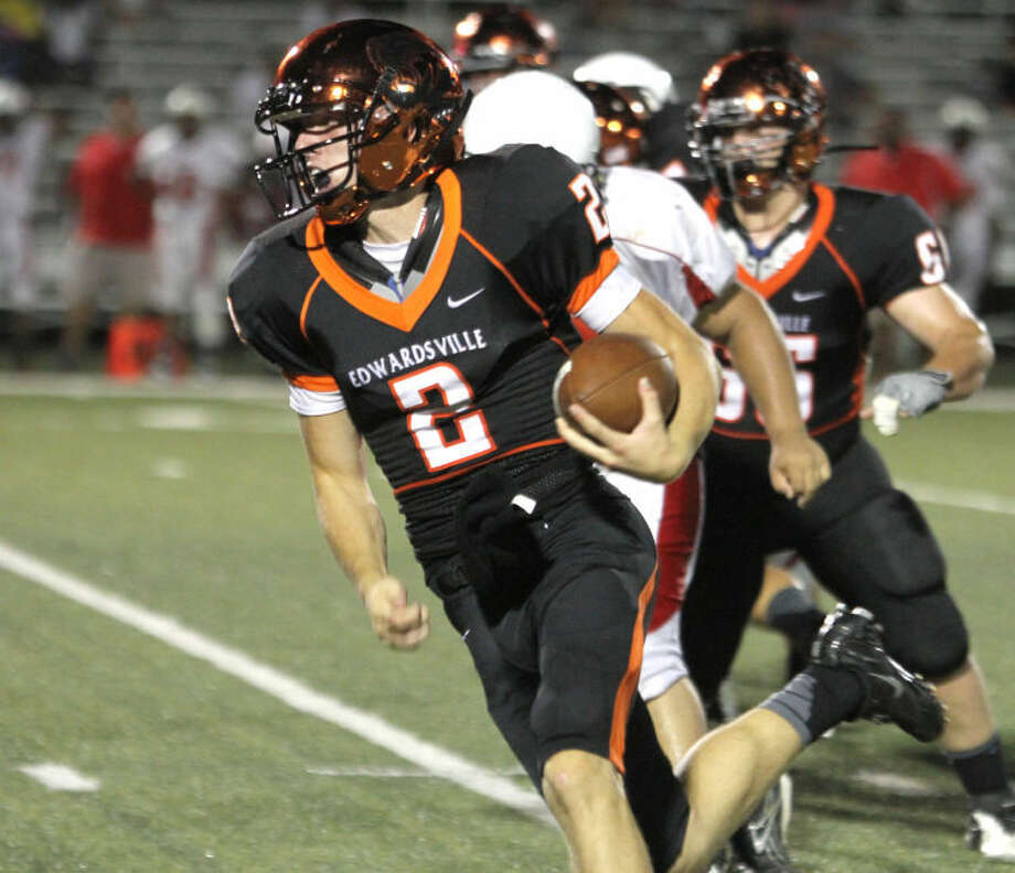 Edwardsville quarterback Dan Marinko runs up the sideline Friday vs. Hazelwood West at the District 7 Sports Complex. Photo: Shawn Semmler