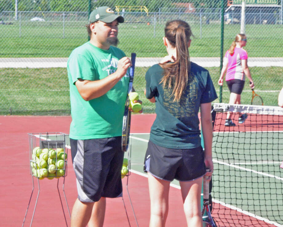 Metro-East Lutheran girls' tennis coach Matt Gehrke explains a drill Wednesday during the first day of practice.