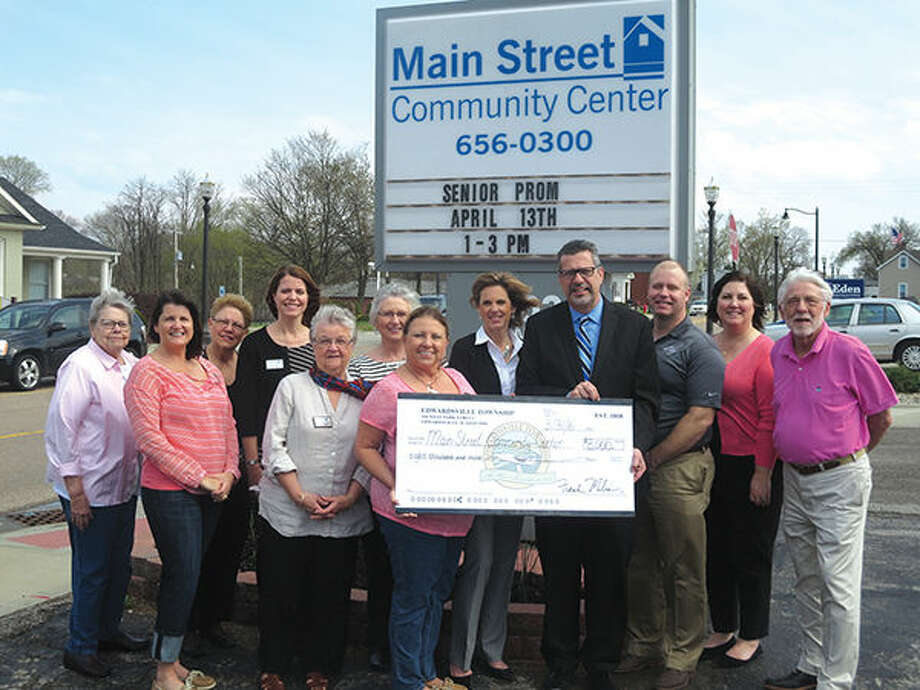 Township Supervisor Frank Miles, center right, presents Main Street Community Center Board Members with an $8,000 check to support programs at the Center.  Front row, from left: JoAnn Nabe, Deb Ellis, Fredna Scroggins, Kathie Duame, Supervisor Frank Miles, Greg Mefford, and Arnold Hoffman.  Back row, from left: Bev Meyer, Emily Bates, Sandy Cooper, Marcia Golden, and Sara Berkbigler, Executive Director of MSCC. Photo: For The Intelligencer