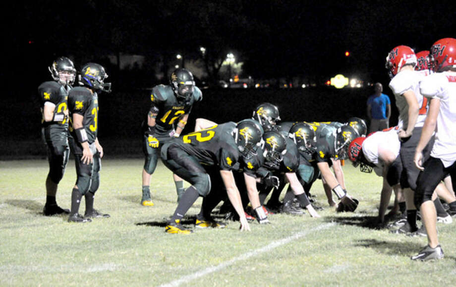 Metro-East Lutheran's offense lines up in the victory formation for the final snap of their 34-27 season-opening victory over Bunker Hill on Friday.