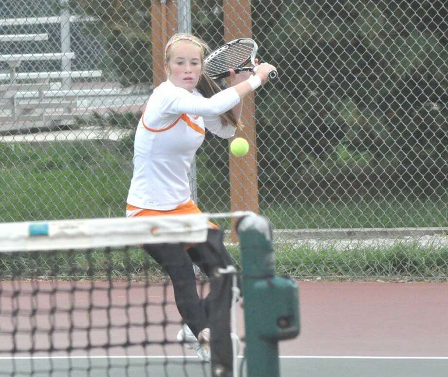 Tiger Callaghan Adams hits a backhand return Saturday at the EHS Tennis Center during No. 1 singles action in the Southwestern Conference Tournament.