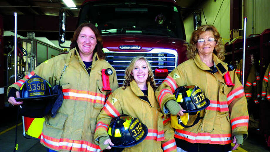 Holiday Shores Fire Department members Ann Clark, RayeLynn Kidwell and Jane Langendorf are three of the female members of the 26 member department. Not pictured: Jessica McConnell.