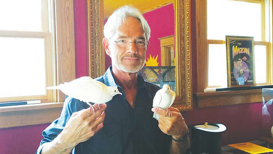 Magician Don Woodruff poses with his 10-year-old pet doves Hocus and Pocus. Woodruff has been practicing illusions and magic tricks for more than 50 years. Photo: Adam McDonald/Intelligencer