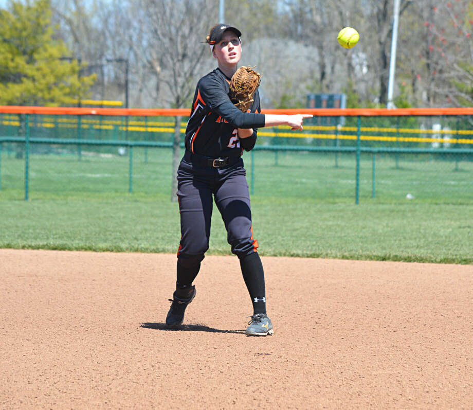 Edwardsville's Jordan Corby makes a throw to first after fielding a ball in the first game of Sautrday's doubleheader.