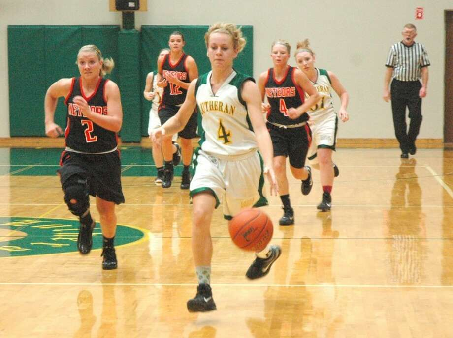 Metro-East Lutheran's Jessica Jumps dribbles toward the basket on a second half breakaway against Marissa at Thomas Hooks Gym on Monday.