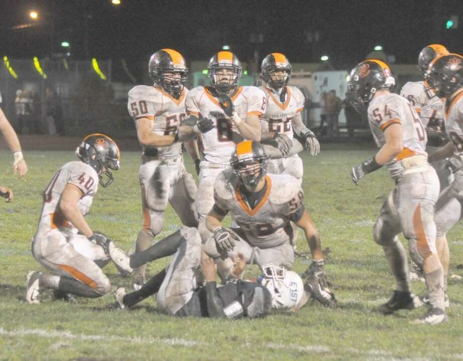 The Tiger defensive players have been the unsung heroes during EHS' current run to a 6-1 record in 2012. EHS defensive players, Cameron Throneberry (40), Kyle Keasey (50), Donte Tinin (8), D'Anthony Knight (22), Zac Rujawitz (54) and Jeff Clubb (59) hover around a downed Belleville East player during Week 7.