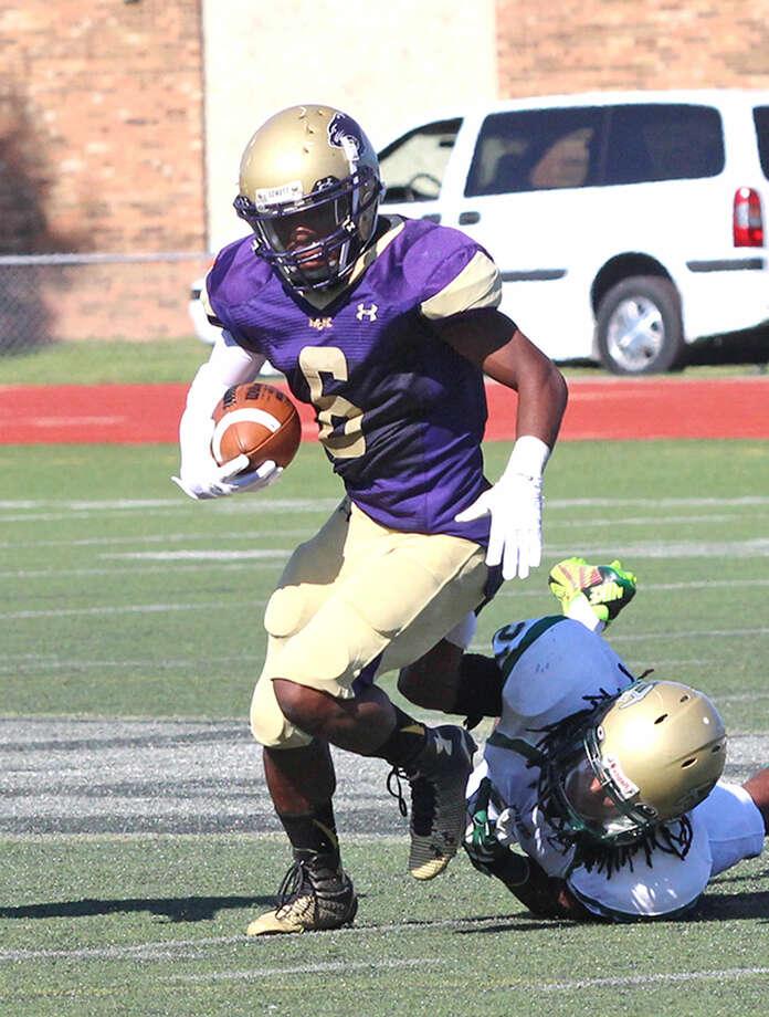 Cameron James dodges a defender during a McKendree University football game. Photo: McKendree University Photos