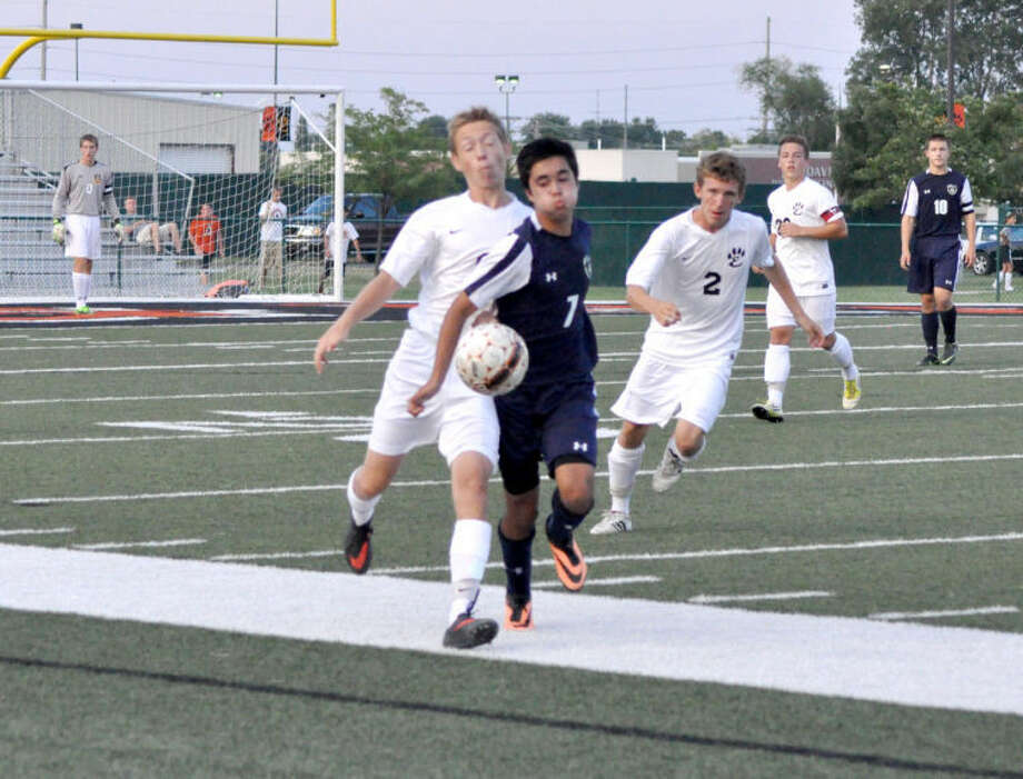 EHS sophomore midfielder Tom Giacobbe battles with O'Fallon's Gus Phelps for a loose ball near midfield.