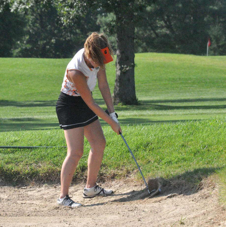 Edwardsville's Megan Quick connects on her shot from the bunker on Hole No. 9 at Belk Park Golf Course in Wood River.