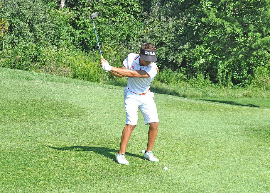 Edwardsville freshman Ben Tyrell hits a shot Tuesday during the Tigers' season opener, the Alton Tee Off Classic at Spencer T. Olin Golf Course