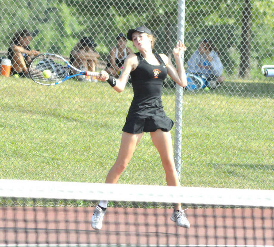 Callaghan Adams hits a return in singles play against Morton on Saturday at the EHS Tennis Center during the Heather Bradshaw Invite.