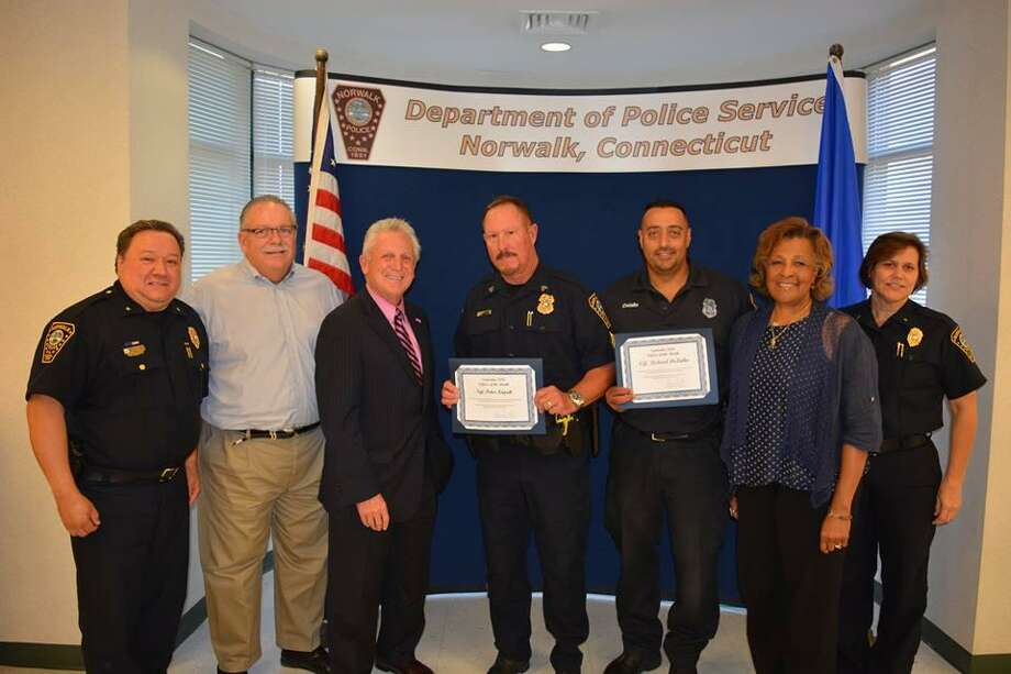 Two Norwalk police officers who participated in a water rescue in Norwalk Harbor and four officers combatting narcotics dealing and illegal gun possession in the city, were recognized recently as the department's September Officers of the Month. Photo: Contributed Photo