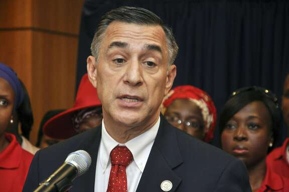 FILE - In this Aug. 4, 2015 file photo U.S. Rep. Darrell Issa, R-Calif., speaks at a news conference at the U.S embassy in Abuja, Nigeria. The fate of endangered California Republicans like U.S. Reps. Steve Knight and Darrell Issa could come down to the motivation of GOP voters. Democrats, meanwhile, are fighting lack of enthusiasm and feelings of inevitability about Hillary Clinton. (AP Photo/Olamikan Gbemiga, File)