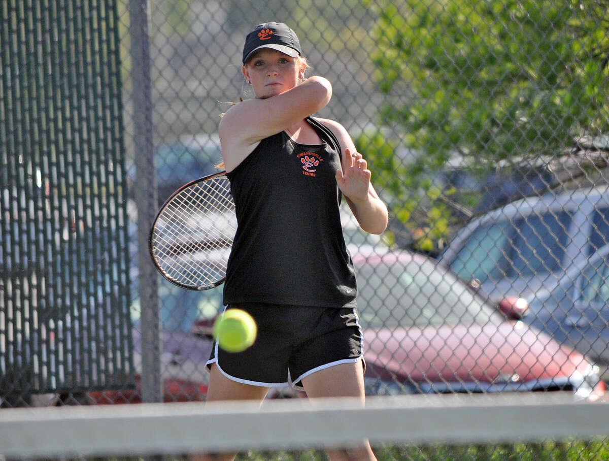Edwardsville's Mackenzie Cadagin watches her shot go over the net during a doubles match against Jerseyville on Wednesday.