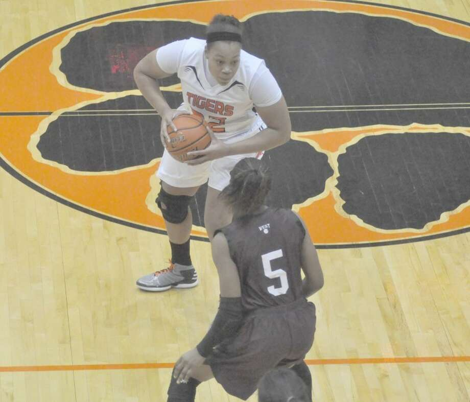 EHS' Emmonnie Henderson looks to dribble past a Belleville West defender at half court on Thursday.