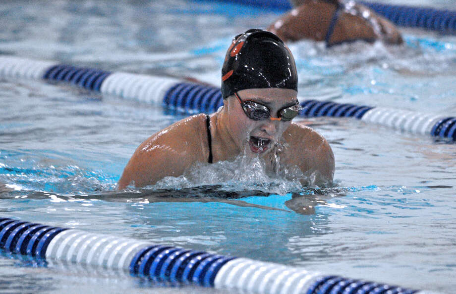 Edwardsville junior Kate May competes in the 100-yard breaststroke during her team's dual against O'Fallon at Chuck Fruit Aquatic Center on Thursday.
