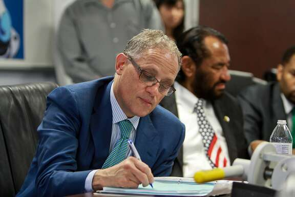 Export-Import Bank of the United States Chairman and President Fred P. Hochberg, left, and U.S. Representative Al Green during a meeting before touring Cooper Valves in Stafford. (For the Chronicle/Gary Fountain, May 7, 2015)