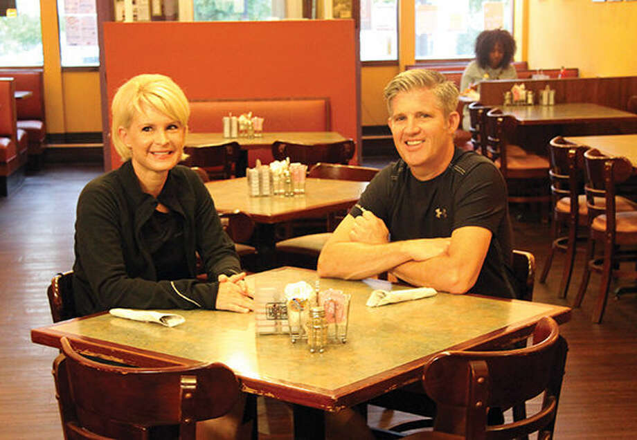 Stacia, Left, And Mike Gorden Sit At A Table Inside Sgt. Pepperu0027s Cafe
