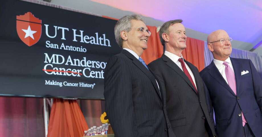William McRaven, University of Texas System chancellor (center) is flanked Tuesday by Dr. Ronald DePinho, president of MD Anderson Cancer Center (left) and William Henrich, UT Health Science Center San Antonio president, after an event announcing the creation of the UT Health San Antonio MD Anderson Cancer Center. Photo: William Luther /San Antonio Express-News / © 2016 San Antonio Express-News