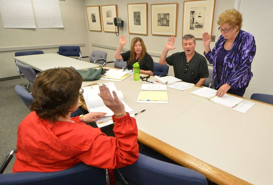 Moderators are sworn in during a training session by Registrar of Voters Karen Doyle Lyons at Norwalk City Hall on Monday April 25 2016 Photo: Alex Von Kleydorff / Hearst Connecticut Media / Connecticut Post