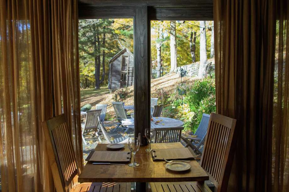 Windows look out over a woodsy setting at John Andrews Farmhouse Restaurant. (Photo by Michelle Girard for JAF.) Photo: Michelle Girard / Michelle Girard Photography