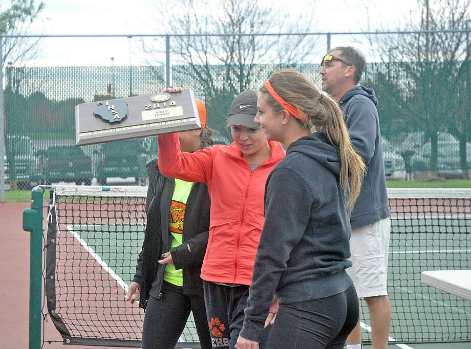 Senior members of the Edwardsville girls' tennis team raise the Edwardsville Sectional championship plaque on Oct. 18.