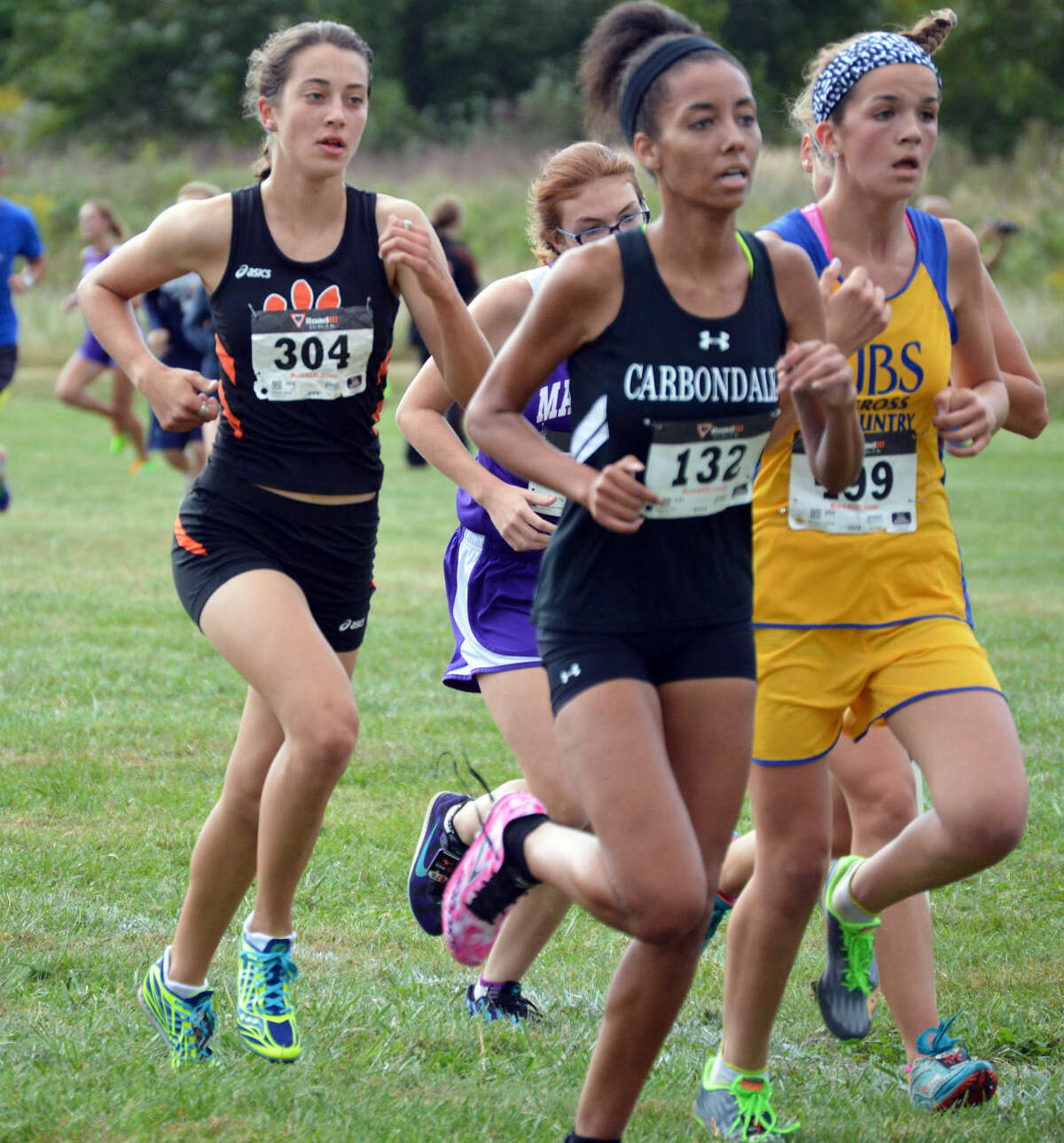 EHS's Maddie Miller (No. 304) is in a pack of runners after the first mile of the Edwardsville Invitational on Saturday at SIUE.