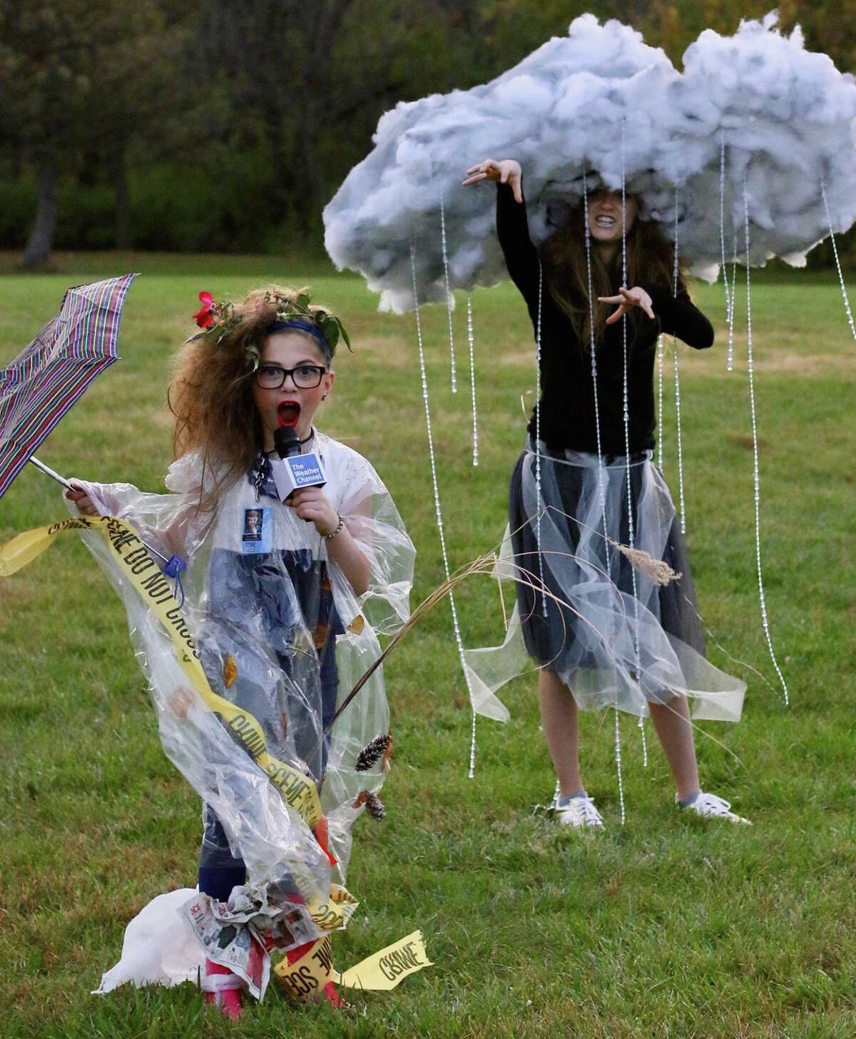 WEATHER REPORTER: Traci Manganiello sends us one of our favorite group costumes of all time. She writes: This just in....tonight's forecast, Cloudy with a chance of candy! These two have dressed up every year since the little one was born, but this year is definitely our favorite!