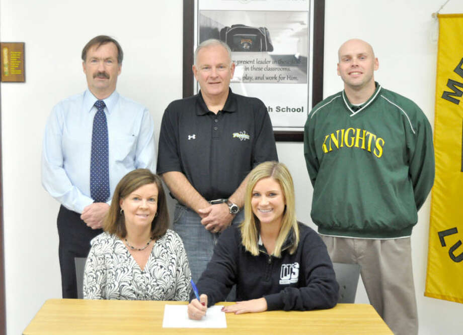 Metro-East Lutheran's Rachel Goff recently signed a letter of intent to play softball at the University of Springfield. Seated from left to right are: Laura Goff, mother and Rachel Goff. Standing from lef to right are: Dave Redden, MELHS athletic director, Henry Goff, father and Rob Stock, MELHS head softball coach.